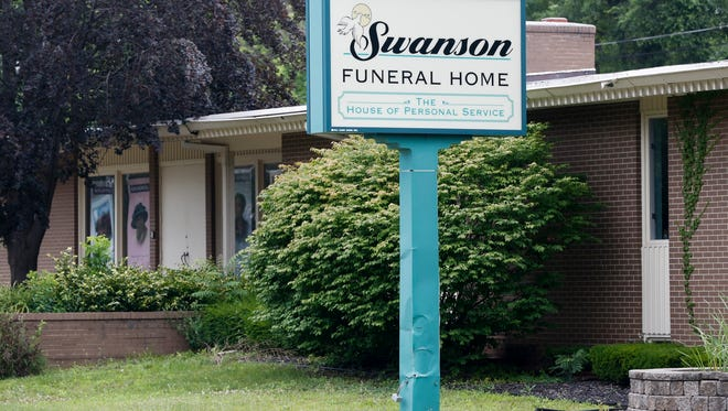 In a July 12, 2017 file photo, the Swanson Funeral Home is seen on Martin Luther King Avenue in Flint, Mich.