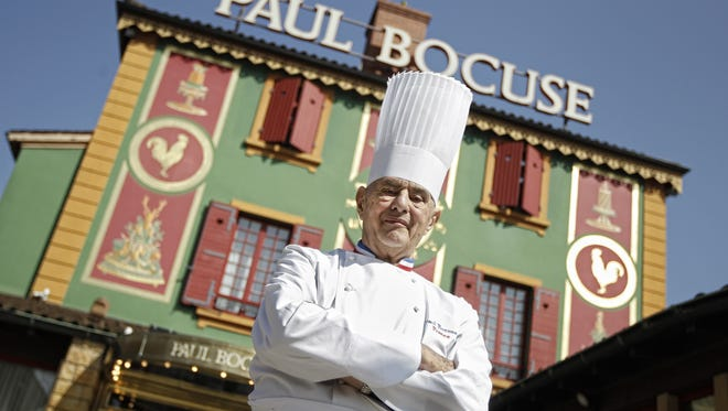 The French chef Paul Bocuse outside his Michelin three-star restaurant L'Auberge du Pont de Collonges in Collonges-au-Mont-d'or, outside Lyon, in 2011.