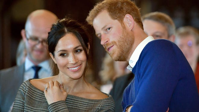 Britain's Prince Harry and his fiancée, U.S. actress Meghan Markle, watch a dance performance by Jukebox Collective during a visit at Cardiff Castle in Cardiff, south Wales on January 18, 2018. The couple will wed on May 19th.