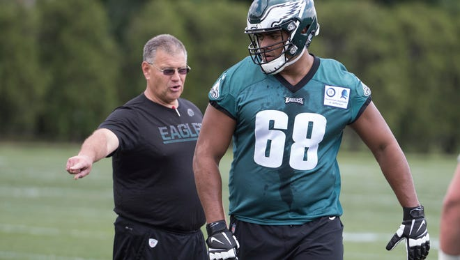 Eagles offensive lineman Jordan Mailata, right, of Australia, gets directed by offense line coach Jeff Stoutland, left, during NFL football rookie minicamp at the team's training facility last Friday.