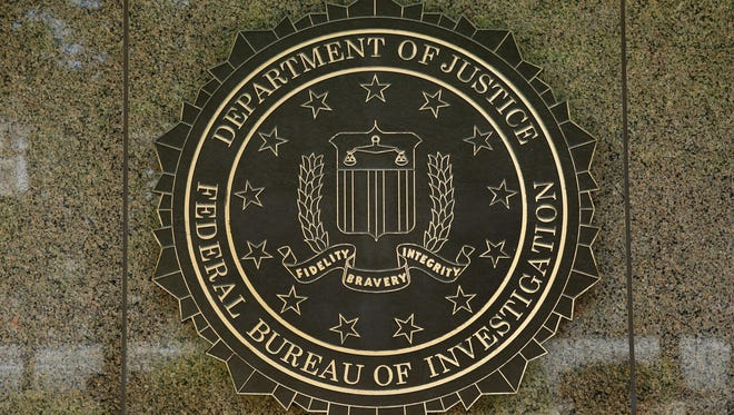 The FBI logo is seen outside the headquarters building in Washington, D.C. On Saturday, June 2, 2018, an off-duty FBI agent accidentally shot a man while dancing at a Denver nightclub.