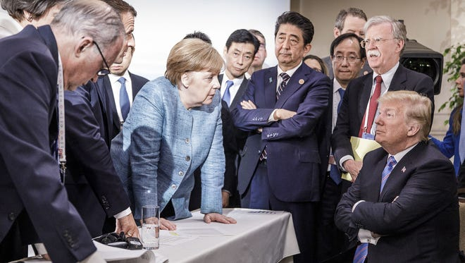 President Trump surrounded by other leaders at the G7 summit in Charlevoix, Canada on June 9, 2018.