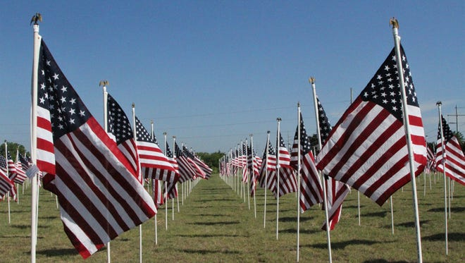 "State Highway 377 in Granbury is colored red, white and blue when ""A Field of Flags"" is presented each Memorial Day weekend."