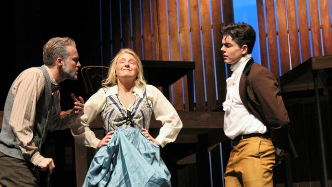 """Kasey Brichfield, center, is the smirking Hostess of the Garter, standing between Easton Orr as Justice Shallow and Andrew Gilliland as Master Page in this rehearsal scene from ACU's """"The Merry Wives of Windsor."""""""
