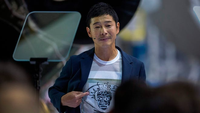 Japanese billionaire Yusaku Maezawa wears a shirt depicting the work of one of his favorite artists during the announcement by Elon Musk that he will be the first private passenger who will fly around the Moon aboard the SpaceX BFR launch vehicle.
