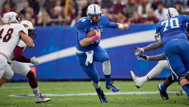 Kentucky quarterback Patrick Towles keeps the ball to gain yards against the Louisiana Monroe defense during the first half of the of an NCAA college football game in Lexington, Ky., Saturday, Oct. 11, 2014. (AP Photo/David Stephenson)