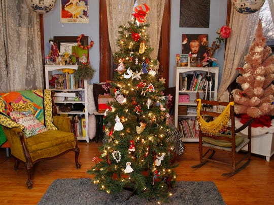 16-year-old Sophia Westcott plants her Christmas tree in the middle of her bedroom.