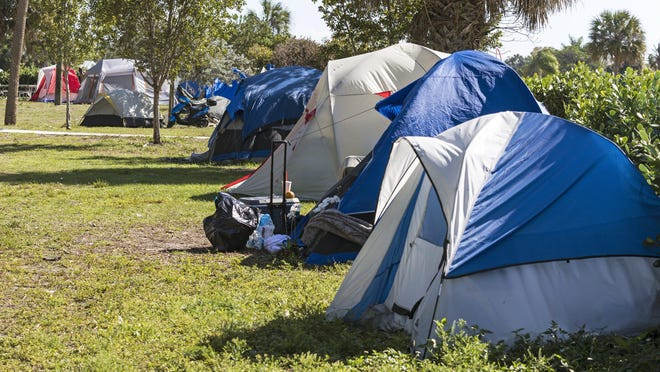 Tent City sprawls out over a football field-size area in John Prince Park west of Lake Worth Beach. Homeless people have erected about 70 tents in the county park and under current law, the county can't force them to leave.