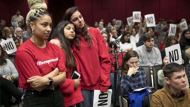 University of Texas students Simona Gabriela Harry, 21, left, Tasnim Islam, 19, and Ana Sofia Ross, 19, listen after Ross asked a question at a UT town hall meeting about sexual misconduct processes in January.