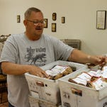 Bob Bracy counts packets going out to carriers as part of a previous Stamp Out Hunger campaign.