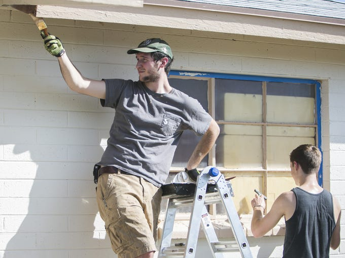 Noah Tyler, of the Red Mountain Community Church, paints