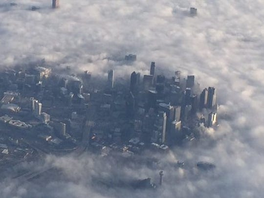 The tallest buildings in the Dallas-Fort Worth, Texas, area poked through low-hanging clouds Friday morning.