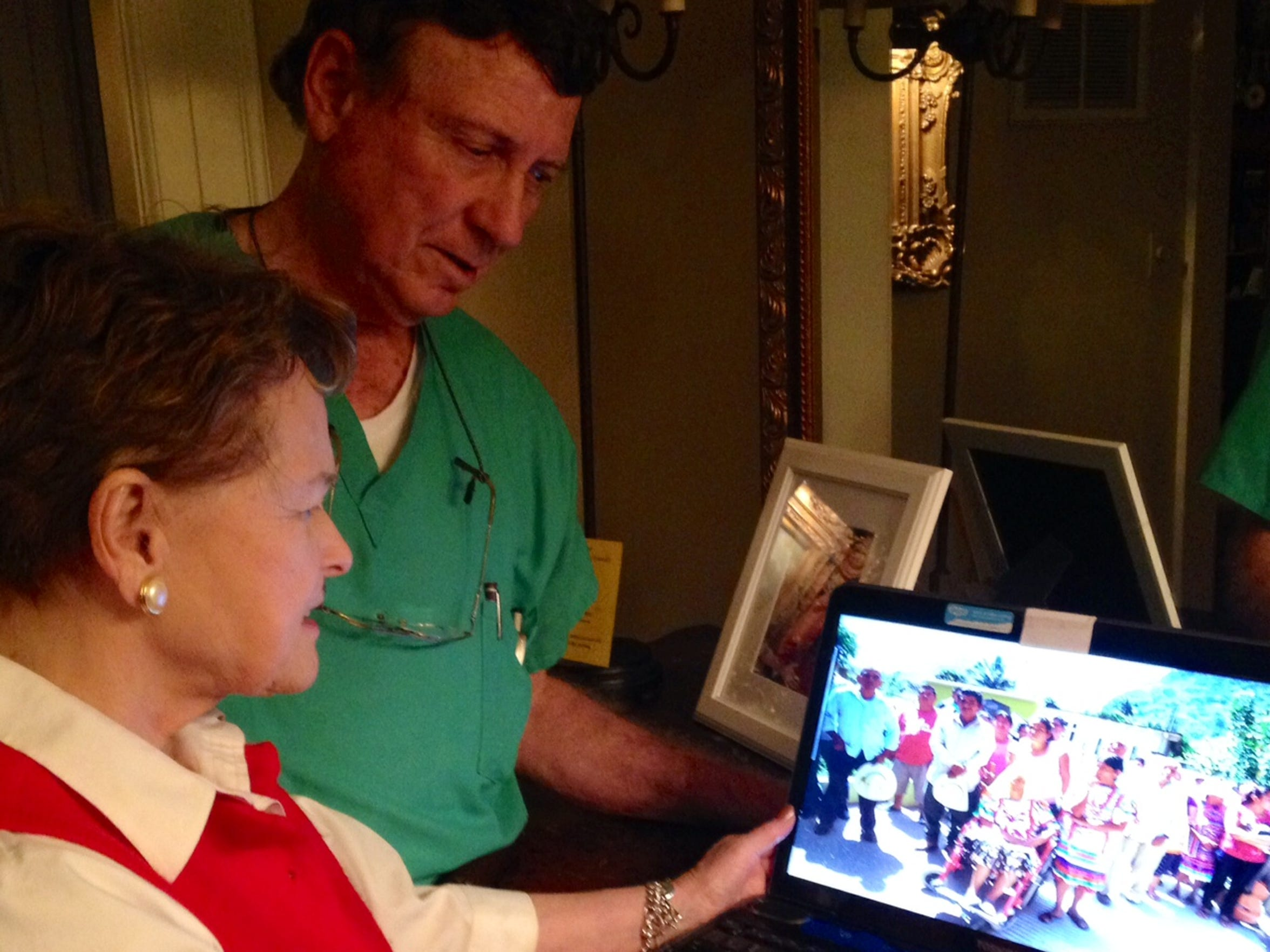 Dr. Tom Robinson and his wife, Daphne, look at a digital