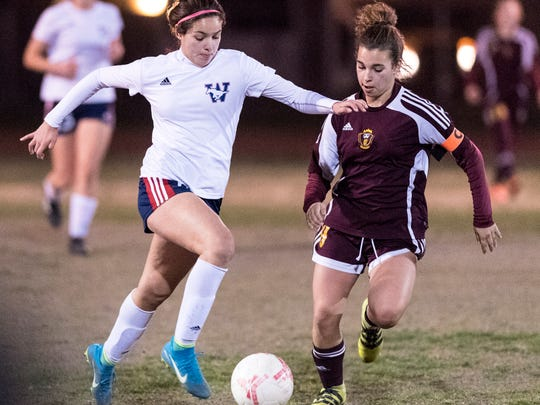 Tulare Western's Melani Medina advances against Tulare Union's Ciera Santos in a Central Section Division II semifinal girls soccer game on Tuesday, February 20, 2018.