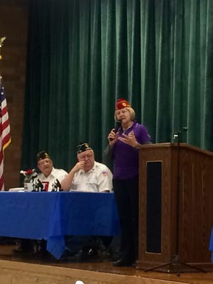 The first National American Legion Commander and Iowa native Denise Rohan addresses Warren County American Legion members during a county-wide meeting at Southeast Warren High School.