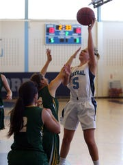 West Morris guard Maddie Selvaggi goes for an jump