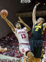Dec 4, 2017; Bloomington, IN, USA; Indiana Hoosiers forward Juwan Morgan (13) shoots the ball while Iowa Hawkeyes forward Jack Nunge (2) defends in the first half of the game at Assembly Hall. Mandatory Credit: Trevor Ruszkowski-USA TODAY Sports