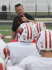 Enquirer file Lakota West coach Larry Cox won his 100th game at the school when the Firebirds defeated Sycamore Oct. 10. He is in his 18th season as head coach there. BN FIREBIRDS HOMETOWN   Coach Larry Cox  at a recent Lakota West Football team practice gives his team a prep talk in West Chester where the Firebird where tuning up for a Friday night game. September 18, 2013 The Enquirer/ Tony Jones