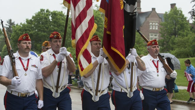 The Memorial Day procession travels along Algoma Boulevard to Riverside Cemetery in Oshkosh on May 25, 2015.