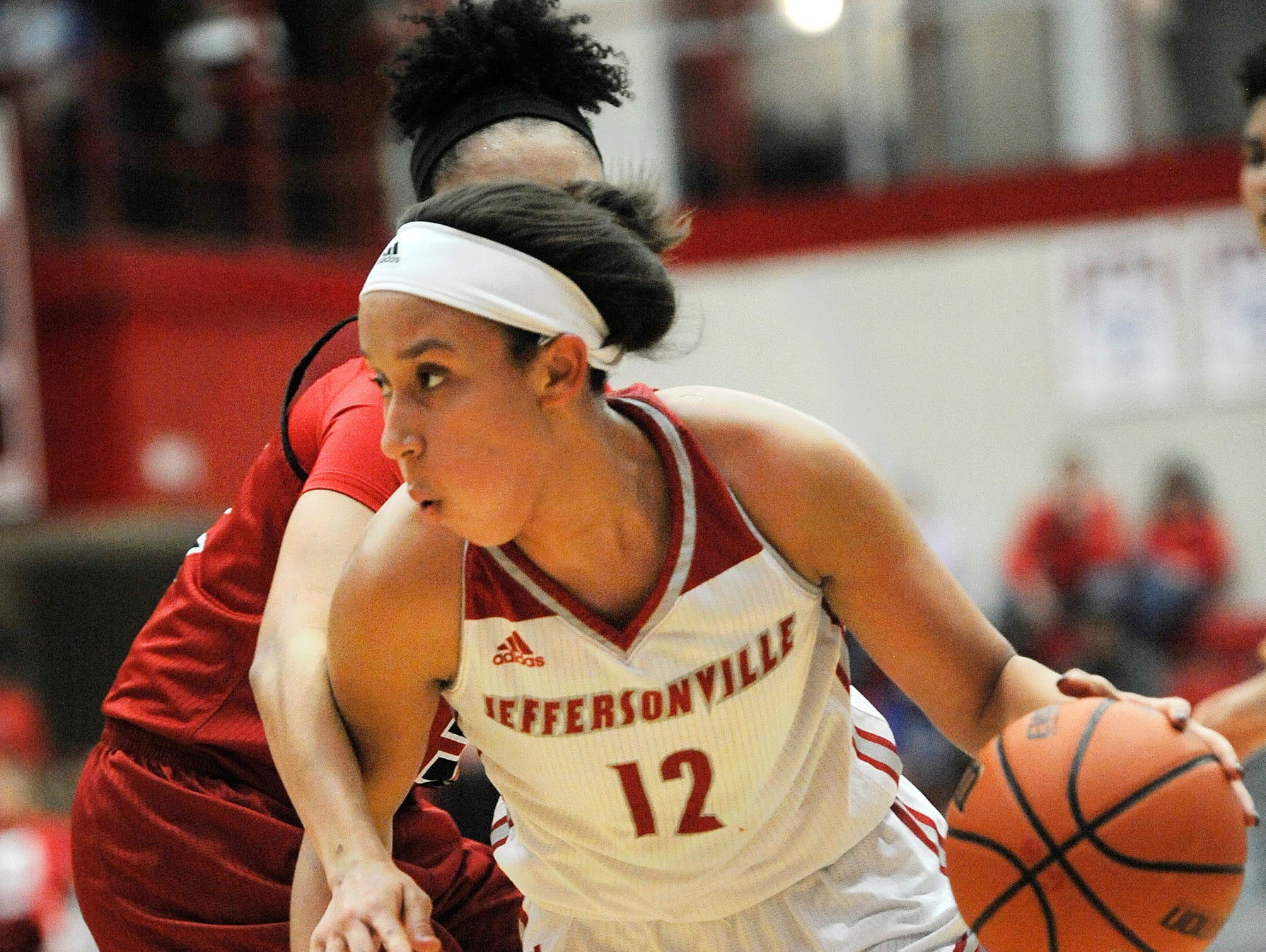 Jeffersonville's Jacinta Gibson (12) drives to the basket against New Albany on Friday at Jeffersonville High School. Jan.20, 2017