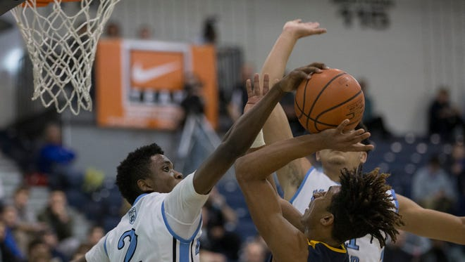 Toms River North's Darrion Carrington tries to shoot but has it blocked by Mater Dei's  Yasin Pretlow during second half action. Toms River North vs Mater Dei in Shore Conference Boys Basketball Semifinal in Toms River on February 21, 2017.