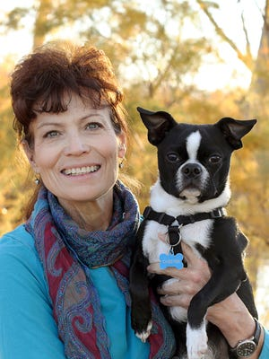 :Dr. Kim Kane, owner of Gift of Goodbye, is pictured here with  her dog, Chester.