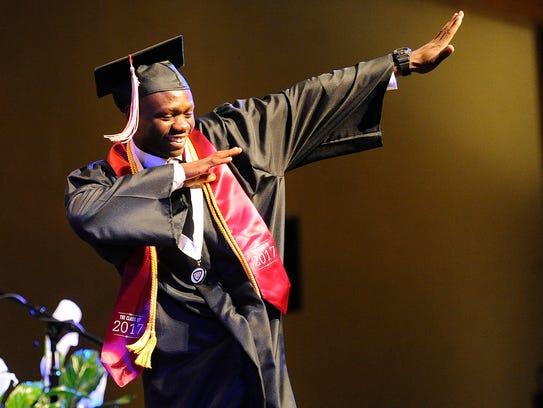 Graduate Mkongo Lucas Lokendo celebrates as he walks
