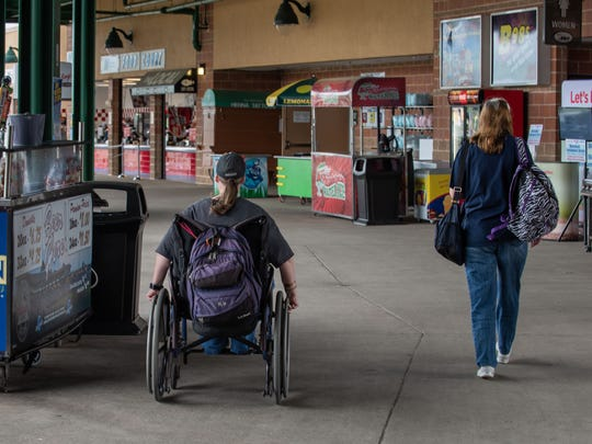 Heather (left) and Sue Walters, longtime season ticketholders, make their way down the concourse at FirstEnergy Park prior to a Lakewood BlueClaws game.
