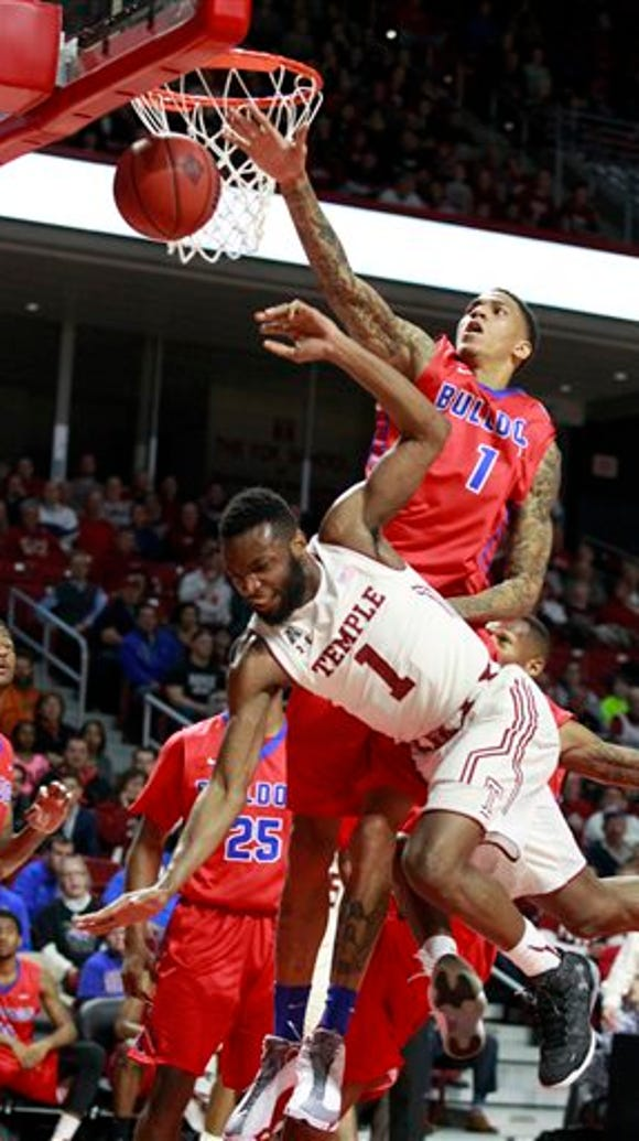 Temple's Josh Brown (1) goes down after being fouled