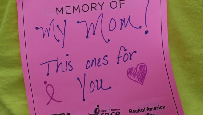 A runner wears a reminder at the Central Wisconsin Race for the Cure in Wausau, Sunday, August 10, 2014.