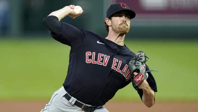 Cleveland Indians starting pitcher Shane Bieber throws during the first inning of a baseball game against the Kansas City Royals, Monday, Aug. 31, 2020, in Kansas City, Mo.