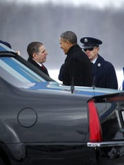 Former President Obama (middle) greeted Lansing Mayor Virg Bernero (left) upon Obama's arrival at Lansing's Capital Region International Airport on Feb. 7, 2014. Bernero appears to have interest in seeking higher office when his term ends.