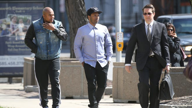April 2015: Mendeecees Harris, center, walks into federal court with his attorney Donald Thompson, right, and a companion. Harris pleaded guilty to drug trafficking charges.