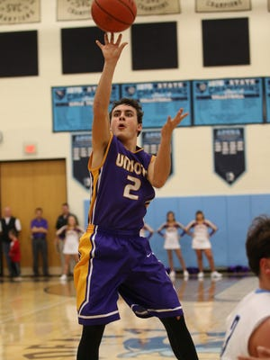 Unioto's Clay Edler puts up a shot attempt against Adena Saturday night at Adena High School. Edler's Shermans won the contest 72-51.