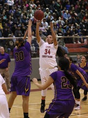 Shiprock's Shontai Grey shoots over Kirtland Central's Krystal Sheka on Jan. 29 at the Chieftain Pit in Shiprock.