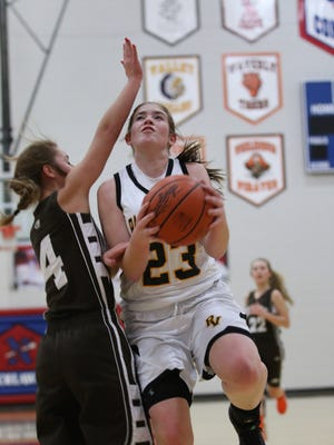 Paint Valley's Lexi Woods is fouled while shooting during the first quarter of Monday night's Division IV sectional semifinal contest against Eastern. The Bearcats beat the Eagles 63-59.