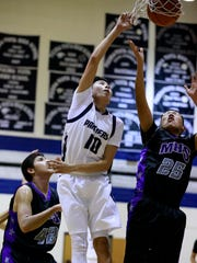 Piedra Vista's Cody Harvey (10) scores while being defended by Miyamura's Isiah Martinez (42) and Gabnan Lee (25) on Friday at the Jerry A. Conner Fieldhouse in Farmington.