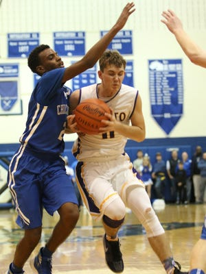 Unioto's Brandon Kennedy works against Chillicothe's Branden Maughmer during the second half of Saturday's Division II sectional final contest at Southeastern High School. Kennedy's Shermans beat the Cavaliers 48-42.