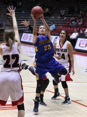 Bloomfield's Kimberlyn Morgan shoots over Portales' Kelly Fraze in the fourth quarter of their 4A quarterfinal game on Tuesday at The Pit in Albuquerque.
