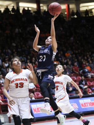 Piedra Vista's Monique Russell beats Gallup's Leona Smith to the basket during their 5A quarterfinal game on Tuesday at The Pit in Albuquerque.