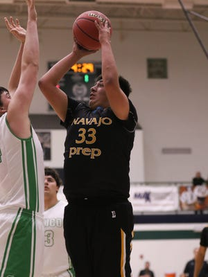 Navajo Prep's Tyler Pete shoots over Texico's Nathan Phipps during the boys 3A quarterfinal game on Wednesday at Rio Rancho High School.