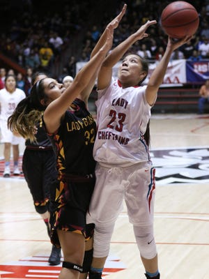 Shiprock's Tanisha Begay shoots over Santa Fe Indian School's Milan Schimmmel during their 4A state semifinal game Thursday at The Pit in Albuquerque.