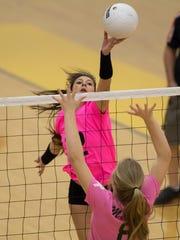 Centennial's Jadyn Nanez tips a ball over the net against