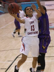 Shiprock's Paige Dale goes up for a layup against Kirtland Central's Haile Gleason Tuesday at the Chieftain Pit in Shiprock.