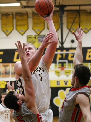 Paint Valley's Dylan Swingle shoots over two defenders in a contest against Westfall earlier this season. Swingle was named the 2016-17 Scioto Valley Conference Player of the Year.