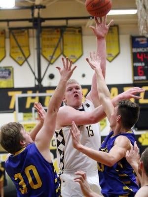 Paint Valley's Dylan Swingle shoots over two Portsmouth Clay defenders earlier this winter. Swingle is the 2016-17 Gazette Player of the Year.