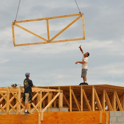 Framers install trusses on a Christopher Burton home
