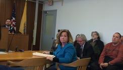 Ramapo Mountain Lakes attorney Eileen Born listens