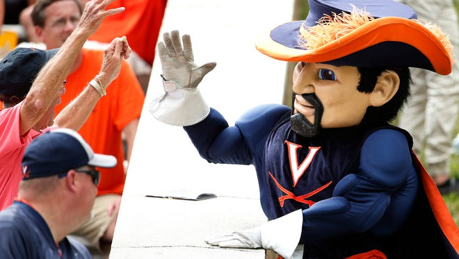 """Virginia Cavaliers mascot """"Cav Man"""" high fives fans in the stands during the second half against the Connecticut Huskies at Scott Stadium on Sept. 16. The Cavaliers won 38-18."""