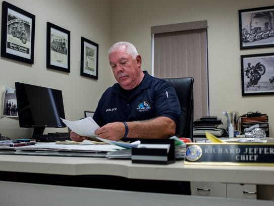 St. Clair Police Chief Richard Jefferson reviews paperwork